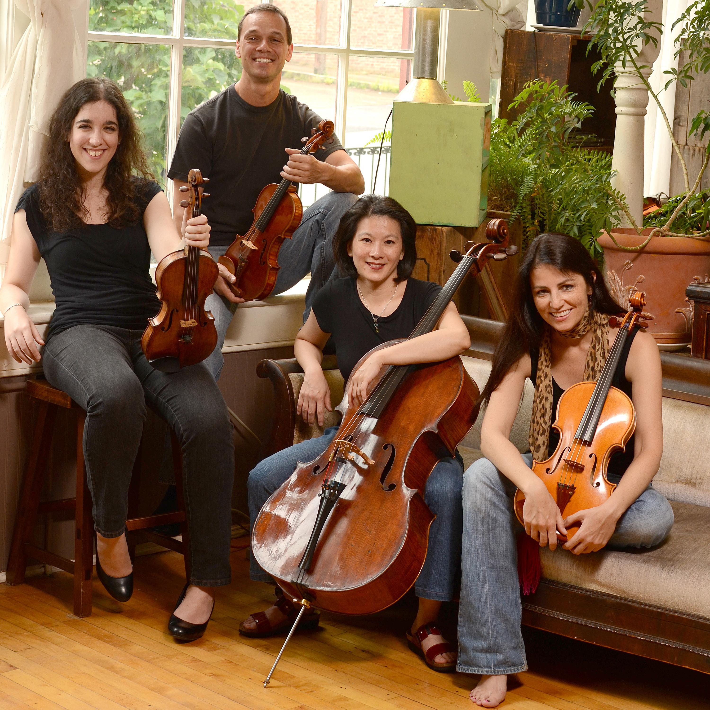 carpe diem string quartet in a casual pose